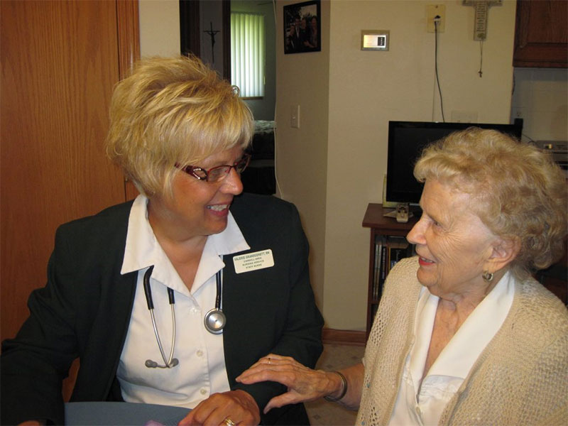 Home health agency nurse talking with client